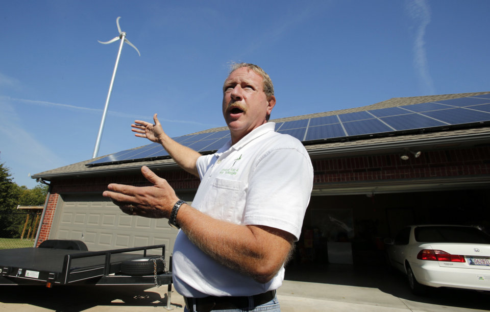 Photo - Choctaw resident Jim Stober talks Wednesday about how solar panels and other alternate energy sources have helped him cut his utility costs.  STEVE SISNEY - THE OKLAHOMAN
