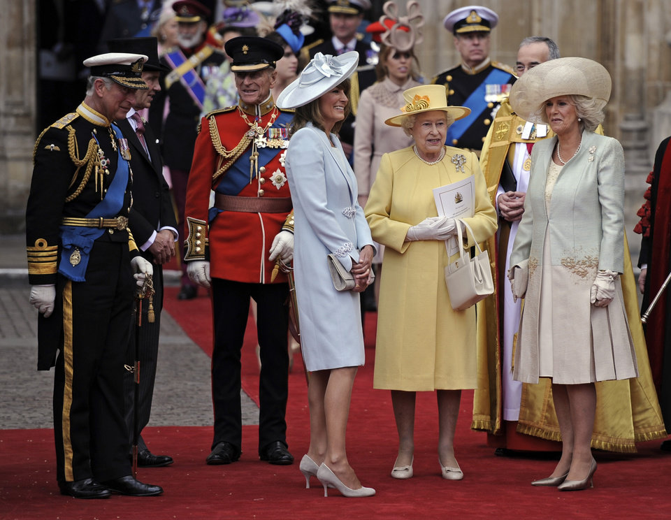 Photo - From left, Prince Charles, Prince Phillip, Carole Middleton, Britain's Queen Elizabeth II and Camilla, Duchess of Cornwall stand outside of Westminster Abbey after the Royal Wedding in London Friday, April, 29, 2011. (AP Photo/Martin Meissner)