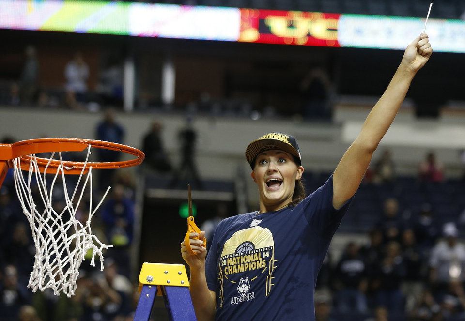Photo - Connecticut center Stefanie Dolson holds the net after the second half of the championship game against Notre Dame in the Final Four of the NCAA women's college basketball tournament, Tuesday, April 8, 2014, in Nashville, Tenn. Connecticut won 79-58. (AP Photo/John Bazemore)