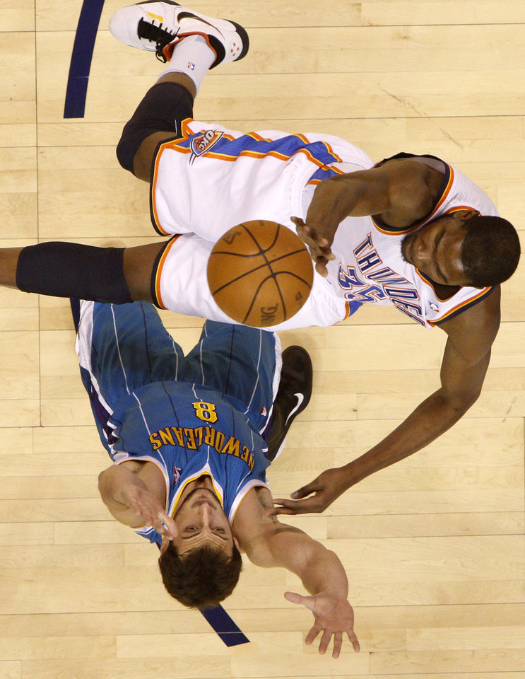 Photo - Oklahoma City's Kevin Durant (35) shoots the ball over New Orleans' Marco Belinelli (8) during the NBA basketball game between the Oklahoma City Thunder and the New Orleans Hornets, Wednesday, Feb. 2, 2011 at the Oklahoma City Arena. Photo by Bryan Terry, The Oklahoman