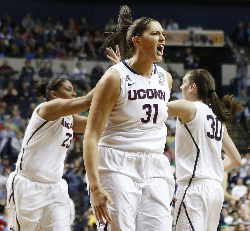 Photo - Connecticut center Stefanie Dolson (31) celebrates a basket against Notre Dame during the first half of the championship game in the Final Four of the NCAA women's college basketball tournament, Tuesday, April 8, 2014, in Nashville, Tenn. (AP Photo/John Bazemore)