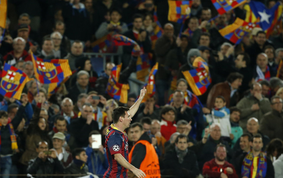 Photo - Barcelona's Lionel Messi celebrates after scoring during a Champions League, round of 16, second leg, soccer match between FC Barcelona and Manchester City at the Camp Nou Stadium in Barcelona, Spain, Wednesday March 12, 2014. (AP Photo/Emilio Morenatti)