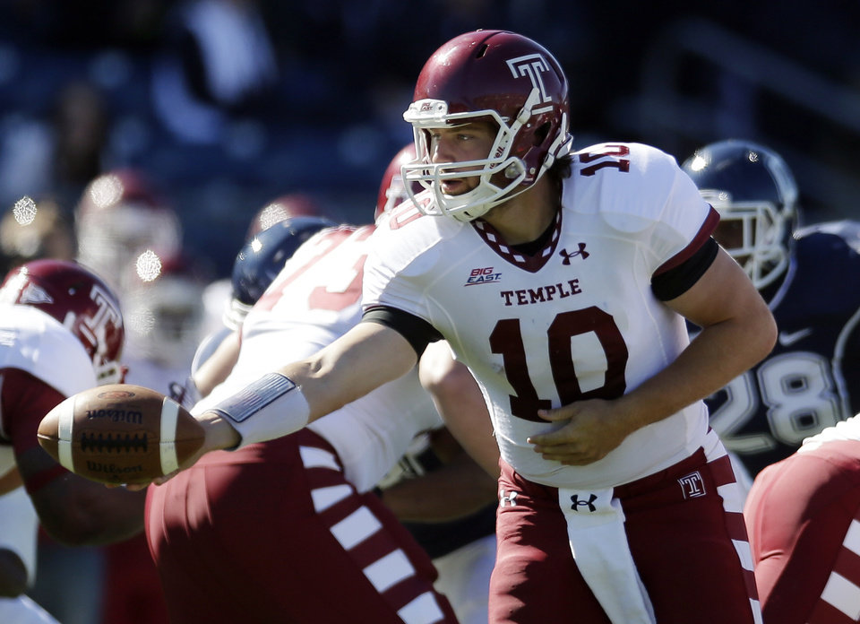 Photo -   Temple quarterback Chris Coyer (10) hands off in the first quarter of an NCAA football game against Connecticut in East Hartford, Conn., Saturday, Oct. 13, 2012. (AP Photo/Michael Dwyer)