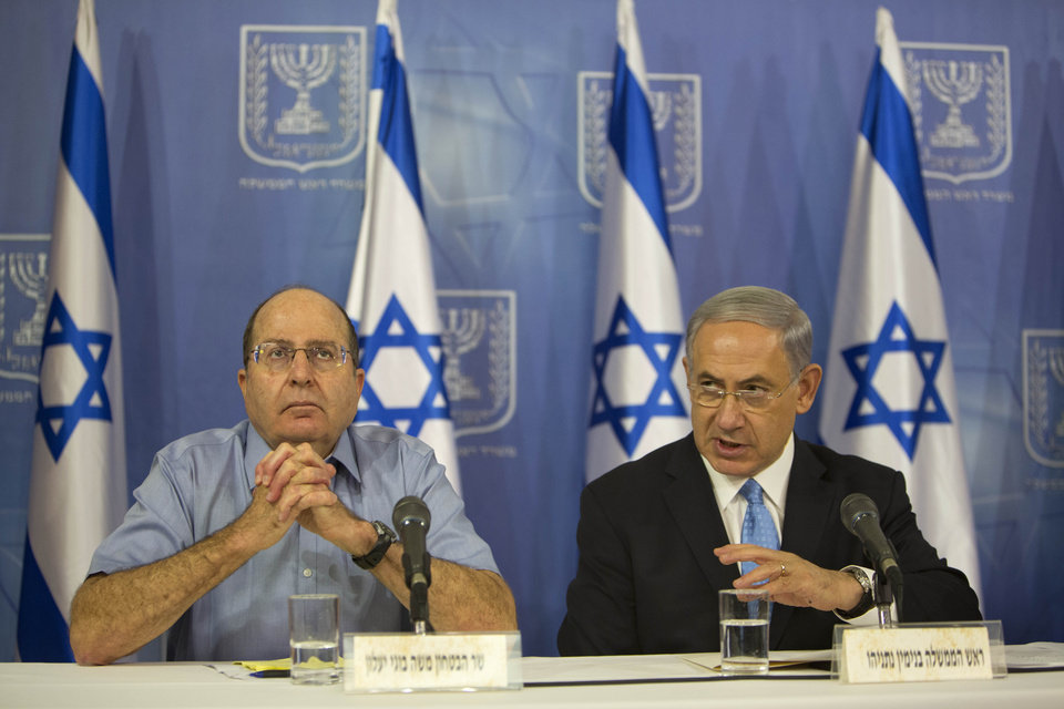 Photo - Israeli Prime Minister Benjamin Netanyahu, right, and Israeli Defense Minister Moshe Ya'alon speak to the media during a press conference at the defense ministry in Tel Aviv, Israel, Saturday Aug. 2, 2014. Netanyahu warned Hamas on Saturday that it will