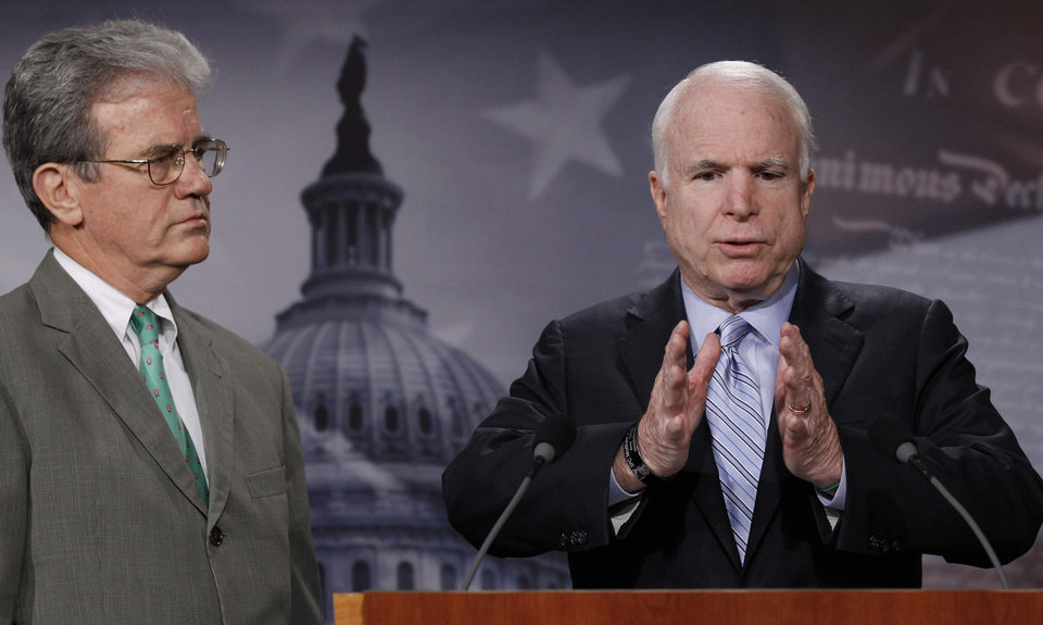 Photo - Sen. John McCain, R-Ariz. right, accompanied by Sen. Tom Coburn, R-Okla., gestures during a news conference on Capitol Hill in Washington Tuesday, Aug. 3, 2010, to discuss concerns with the economic stimulus package. (AP Photo/Alex Brandon) ORG XMIT: DCAB109