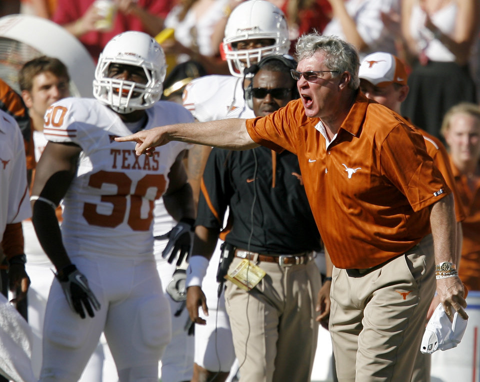 Photo - Texas coach Mack Brown argues a call during the second half of the Red River Rivalry college football game between the University of Oklahoma Sooners (OU) and the University of Texas Longhorns (UT) at the Cotton Bowl on Saturday, Oct. 2, 2010, in Dallas, Texas. OU defeated Texas 28-20.   Photo by Bryan Terry, The Oklahoman