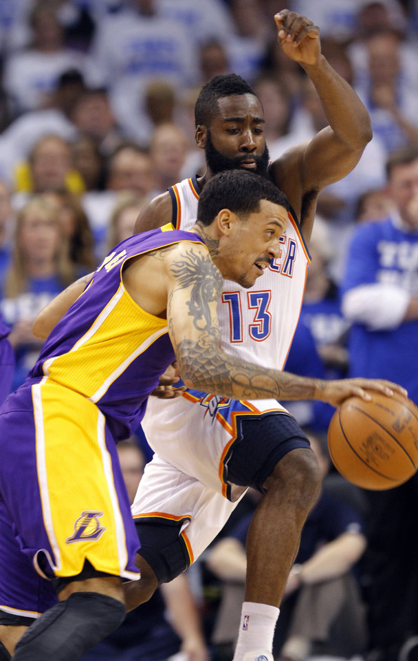 Photo - Oklahoma City's James Harden defends on Los Angeles' Matt Barnes during Game 2 in the second round of the NBA playoffs between the Oklahoma City Thunder and the L.A. Lakers at Chesapeake Energy Arena on Wednesday,  May 16, 2012, in Oklahoma City, Oklahoma. Photo by Chris Landsberger, The Oklahoman