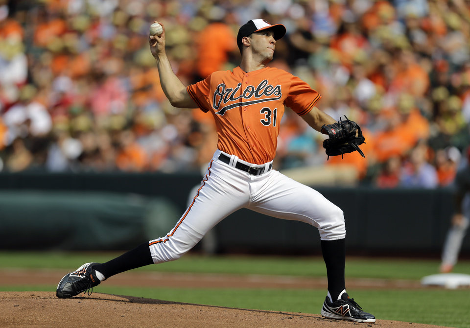 Photo - Baltimore Orioles starting pitcher Ubaldo Jimenez throws to the St. Louis Cardinals in the first inning of an interleague baseball game, Saturday, Aug. 9, 2014, in Baltimore. (AP Photo/Patrick Semansky)