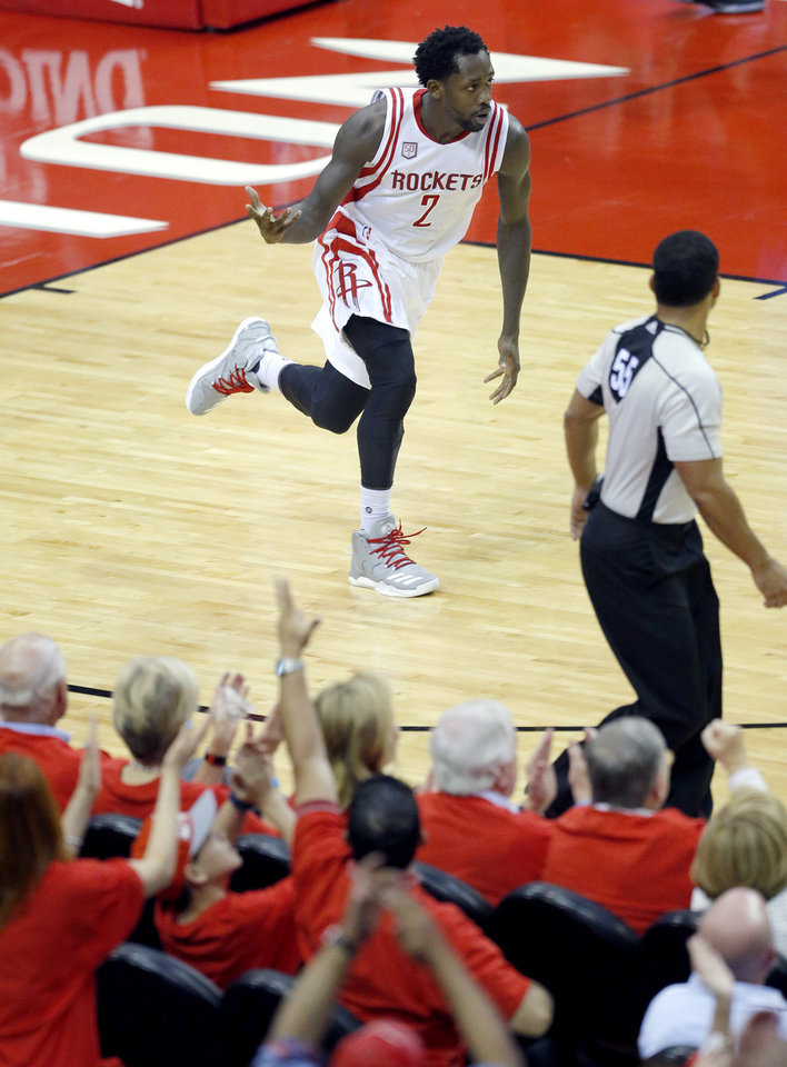 Photo - Houston's Patrick Beverley (2) celebrates during Game 5 in the first round of the NBA playoffs between the Oklahoma City Thunder and the Houston Rockets in Houston, Texas,  Tuesday, April 25, 2017.  Houston won 105-99. Photo by Sarah Phipps, The Oklahoman