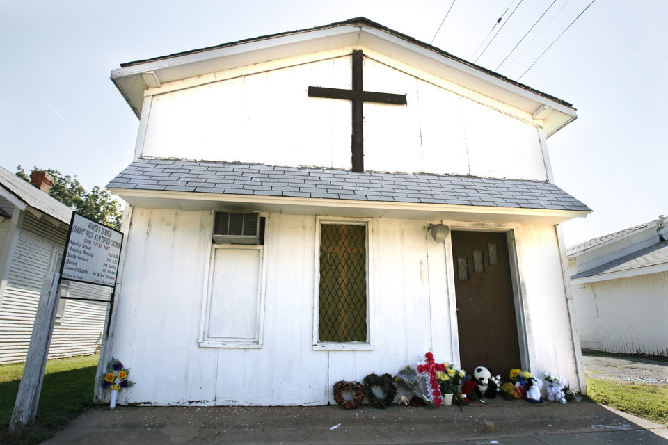 Photo - CHRIST HOLY SANCTIFIED CHURCH / MURDER / HOMICIDE / MEMORIAL / BUILDING EXTERIOR: Flowers and stuffed animals and mementos are placed at the entrance to the church where The Rev. Carol Daniels was killed on Sunday, August 23, 2009 in Anadarko, Okla.  By Steve Sisney, The Oklahoman ORG XMIT: KOD