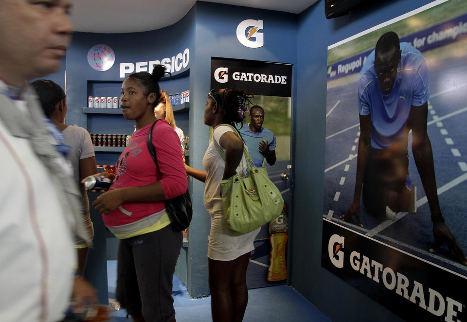In this picture taken Wednesday Nov. 7, 2012 people visits the Pepsi/Gatorade stand during the 30th Havana International Trade Fair, in Havana, Cuba. Many of America's best-known brands were on display at a Havana exposition center this past week as representatives hawked some of the few U.S. products that can legally be exported to Cuba, thanks to an exception to the U.S. embargo allowing cash-up-front sales of food, agricultural goods and medicine.(AP Photo/Franklin Reyes)