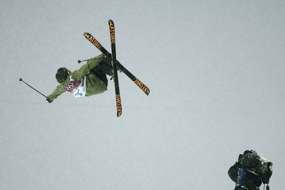 Photo - Switzerland's Yannic Lerjen catches air as he competes during the men's freestyle skiing halfpipe qualification at the Rosa Khutor Extreme Park, at the 2014 Winter Olympics, Tuesday, Feb. 18, 2014, in Krasnaya Polyana, Russia. (AP Photo/Jae C. Hong)