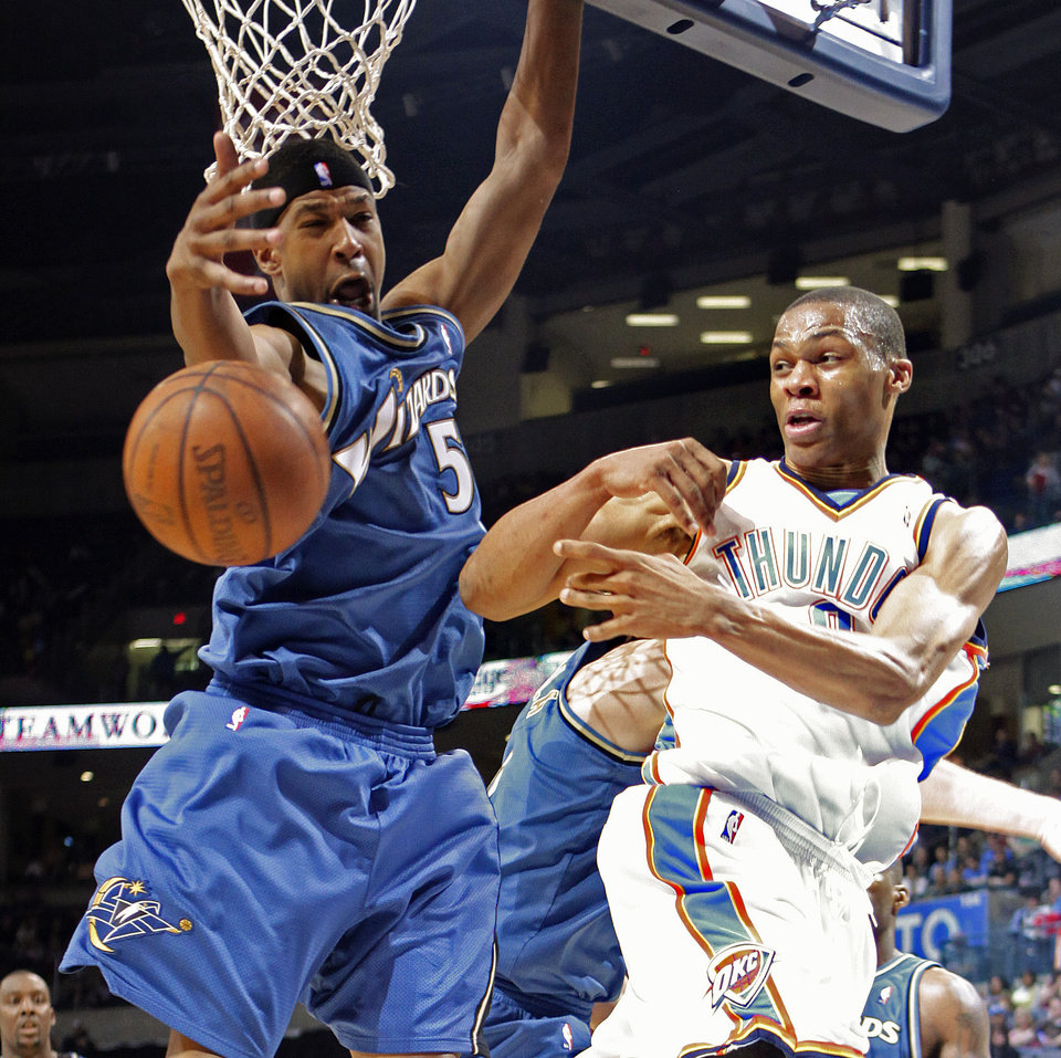 Oklahoma City's Russell Westbrook passes by Washington's Dominic McGuire during the NBA basketball game between the Oklahoma City Thunder and the Washington Wizards at the Ford Center in Oklahoma City, Wed., March 4, 2009. PHOTO BY BRYAN TERRY, THE OKLAHOMAN ORG XMIT: KOD