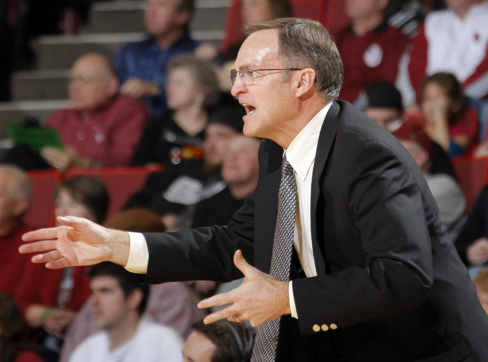 Photo - Oklahoma head coach Lon Kruger coaches during the men's college basketball game between the University of Oklahoma  and Texas Tech University of at the Lloyd Nobel Center in Norman, Okla., Tuesday, Jan. 17, 2012. Photo by Sarah Phipps, The Oklahoman