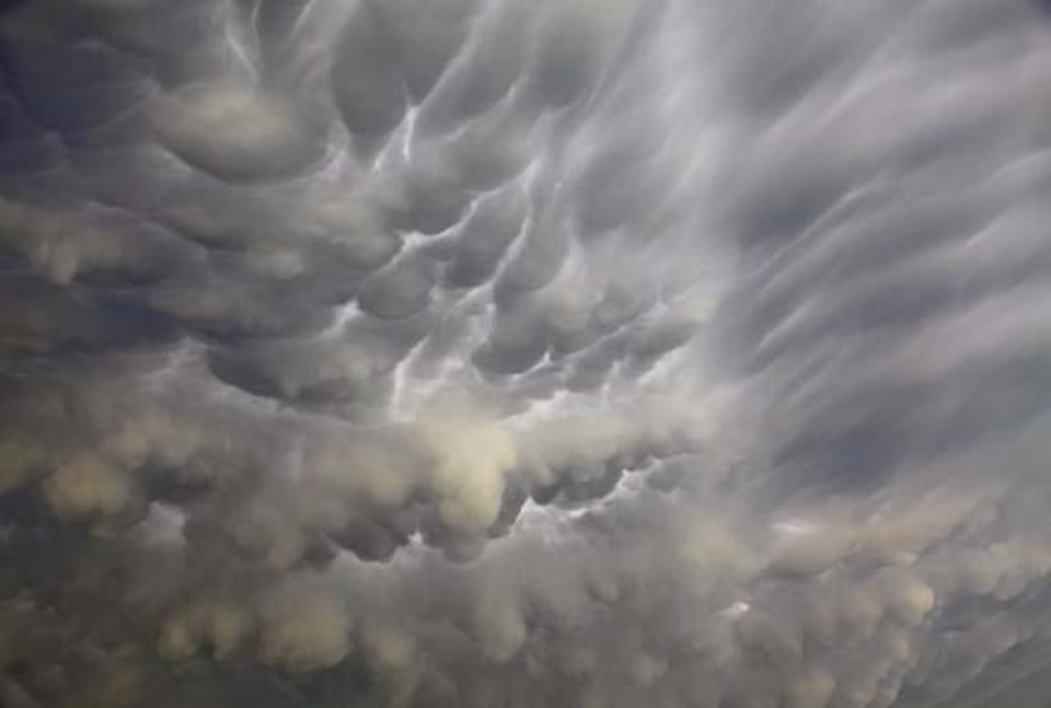 Photo -  Storm clouds build in Yukon, Okla. on Wednesday, May 13, 2009.  Photo by Chris Landsberger, The Oklahoman