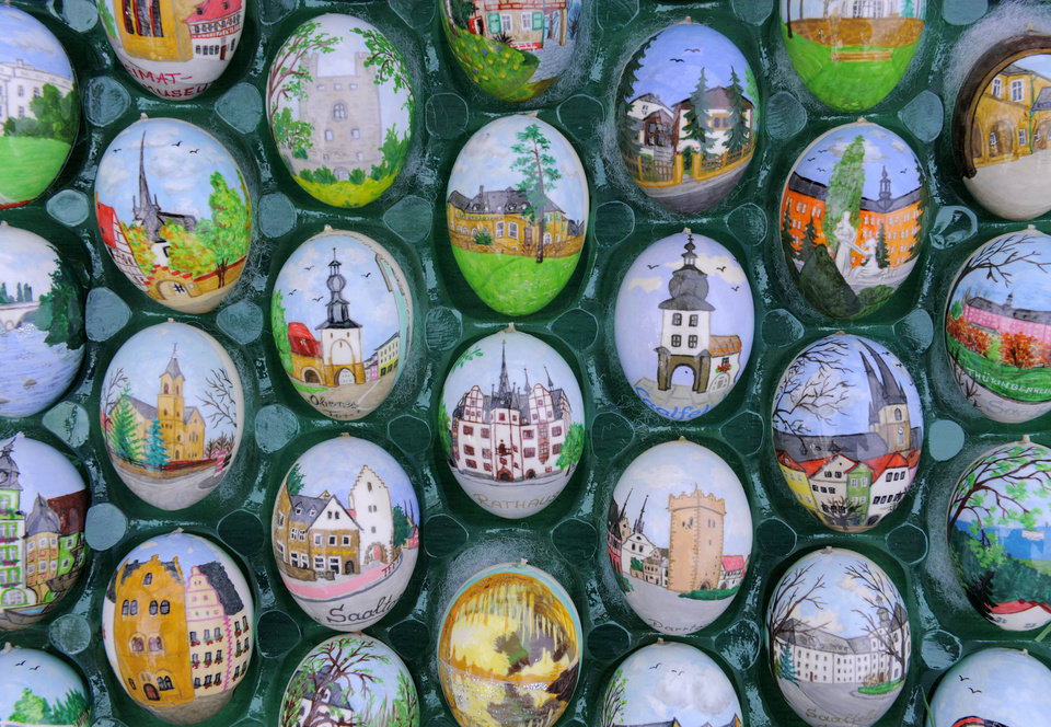Photo - FILE - The April 11, 2011 file photo shows decorated Easter eggs in the exhibition of pensioner couple Christa and Volker Kraft's garden in Saalfeld, Germany. Volker Kraft's apple sapling sported just 18 eggs when he first decorated it for Easter. Four decades later, the sturdy tree is festooned with 9,800 eggs, artfully decorated with everything from beads to sea shells. (AP Photo/Jens Meyer, file)