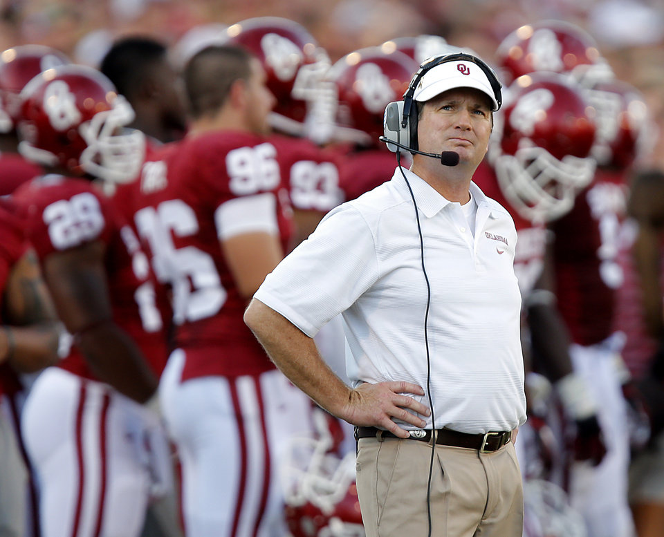 Coach Bob Stoops looks as the replay during the Sooners slow start during the college football game between the University of Oklahoma Sooners (OU) and the University of Louisiana Monroe Warhawks (ULM) at the Gaylord Family Memorial Stadium on Saturday, Aug. 31, 2013 in Norman, Okla.  Photo by Chris Landsberger, The Oklahoman