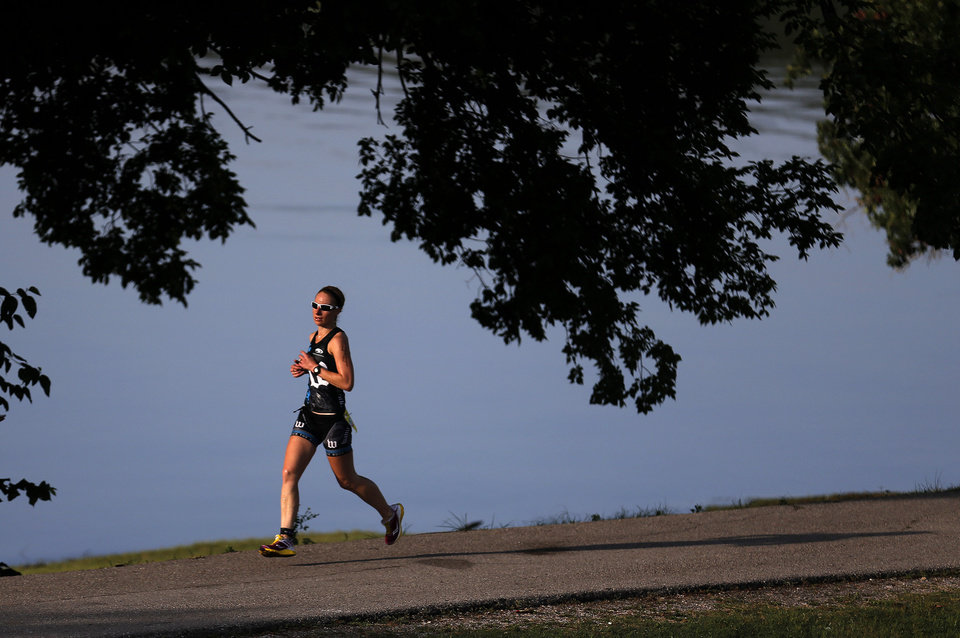 Sarah Stanistreet  of Oklahoma City runs during the Arcadia Lake Triathlon and Aquabike in at Edmond Park in Arcadia Lake, Sunday, Aug 11, 2013. The race was 500 yd swim, 12.4 Mile/20k bike and a 3.1 mile/5k run. Photo by Sarah Phipps, The Oklahoman