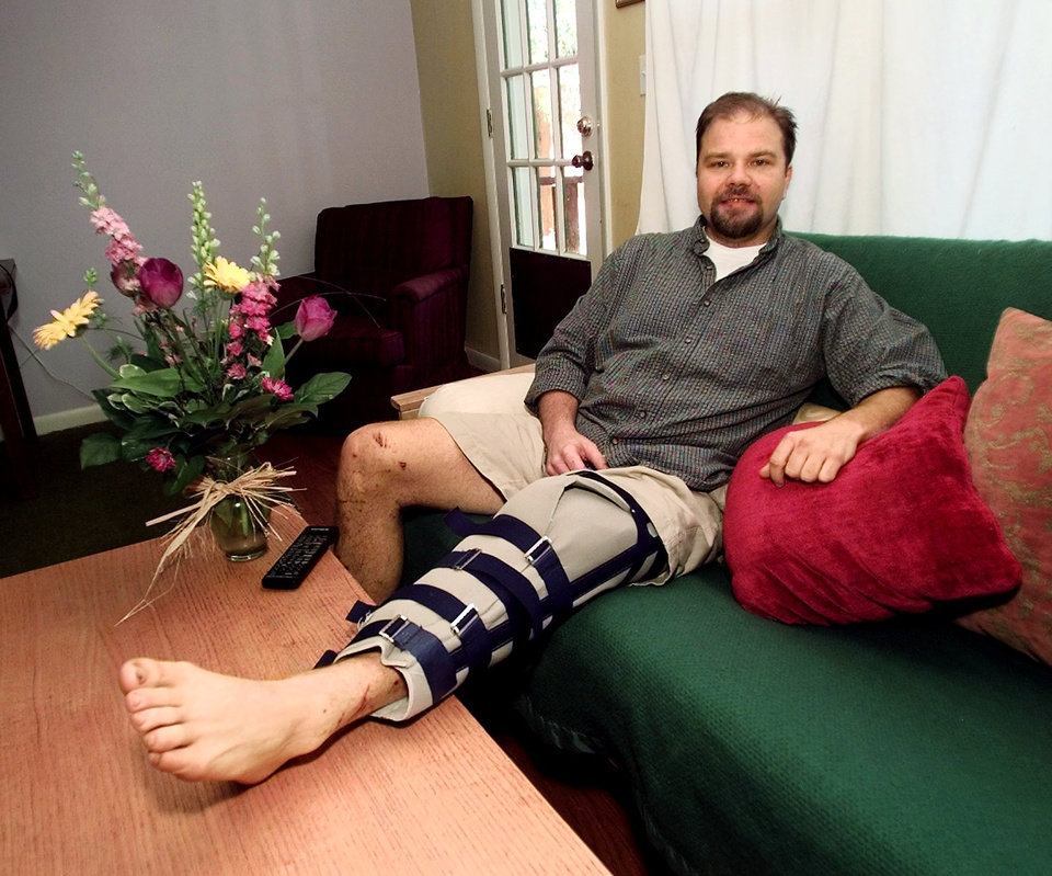 TORNADO VICTIM SCOTT PITTMAN SITS AT HOME ON HIS COUCH IN NORMAN AND RECOVERS FROM HIS INJURIES HE SUSTAINED DURING MONDAY'S TORNADO. SCOTT SAVED   A BOY DURING THE TORNADO.
