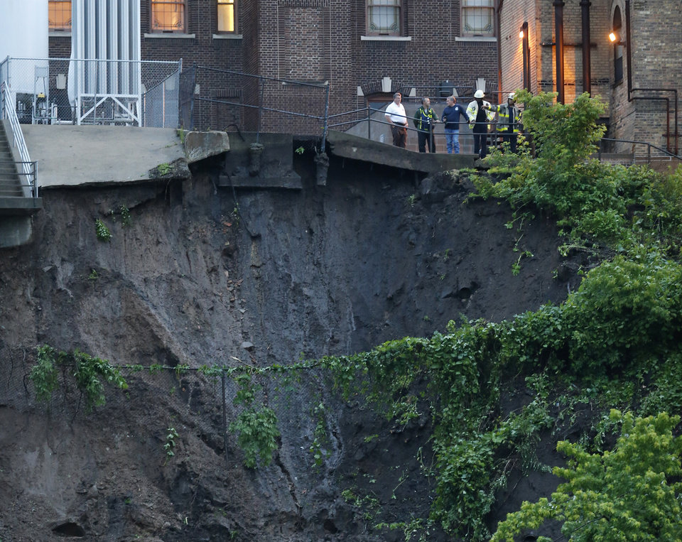 Photo - A mudslide on West River Road threatens the University of Minnesota Medical Center Fairview Hospital complex on the West Bank in Minneapolis, Minn., Thursday, June 19, 2014. The Pioneer Press reports 20 administrative employees of the hospital were evacuated as a precaution. Patients were not affected. The mudslide comes after torrential rain and flash flooding in the area Thursday. (AP Photo/The Star Tribune, Richard Tsong-Taatarii)  MANDATORY CREDIT; ST. PAUL PIONEER PRESS OUT; MAGS OUT; TWIN CITIES LOCAL TELEVISION OUT
