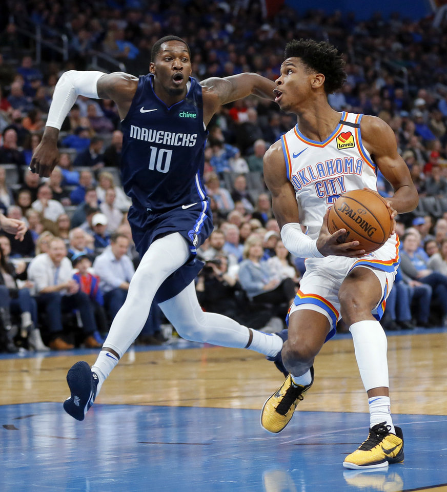 Photo - Oklahoma City's Shai Gilgeous-Alexander (2) looks to score past Dallas' Dorian Finney-Smith (10) during an NBA basketball game between the Oklahoma City Thunder and Dallas Mavericks at Chesapeake Energy Arena in Oklahoma City, Monday, Jan. 27, 2020. [Nate Billings/The Oklahoman]