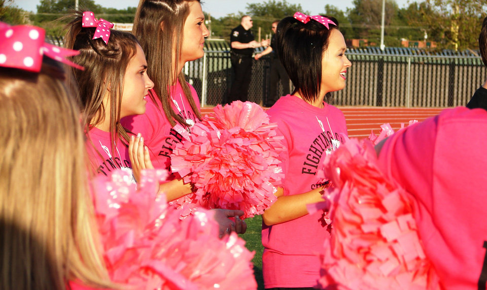 Photo - Pom squad members, from left to right, Hannah Milam, Brittany Snolis and Allison Freeman, wear pink t-shirts during last week's Putnam City-Putnam City West game at Putnam City Stadium for Win-Win Week. Win-Win Week is a statewide effort by Oklahoma high schools to support cancer awareness. PHOTO PROVIDED