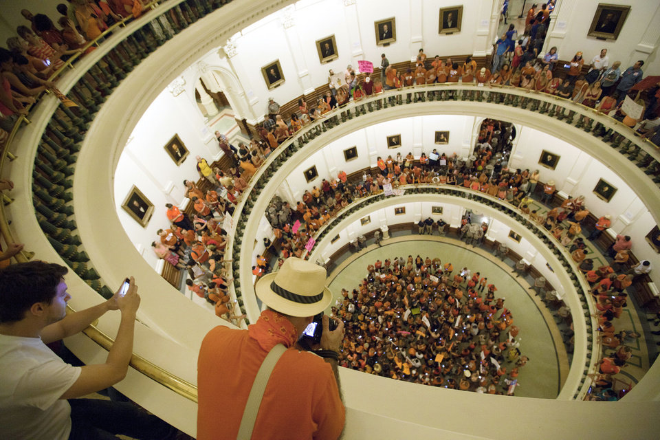 Photo - Abortion rights advocates fill the rotunda of the State Capitol as the Senate nears the vote on Friday night, July 12, 2013. Texas senators were wrapping up debate on sweeping abortion restrictions Friday night and were poised to vote on a measure after weeks of protests. (AP Photo/Tamir Kalifa)