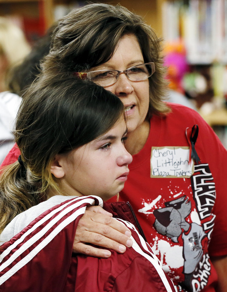 Plaza Towers 3rd-grade teacher Cheryl Littlejohn hugs 4th-grader Tori Roysdon, 11, during a meet and greet with teachers and students from Plaza Towers Elementary at Eastlake Elementary School in Oklahoma City, Thursday, May 23, 2013. Seven Plaza Towers students died when a tornado destroyed the school in Moore, Okla., on Monday. Photo by Nate Billings, The Oklahoman