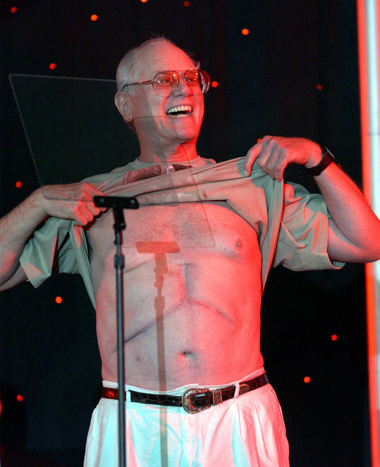Photo -   FILE - In this Wednesday, July 28, 2004 file photo provided by the National Kidney Foundation, actor Larry Hagman bares his chest to show off his scar from his liver transplant surgery at the opening ceremonies of the 2004 U.S. Transplant Games in Minneapolis, Minn. Actor Larry Hagman, who for more than a decade played villainous patriarch JR Ewing in the TV soap Dallas, has died at the age of 81, his family said Saturday Nov. 24, 2012. (AP Photo/Eric Miller, File)