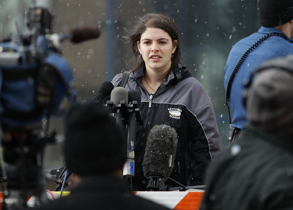 Photo - Jessica Watts, whose cousin was killed in the Aurora movie theater shooting, speaks with members of the media following a court proceeding for Aurora theater shooting suspect James Holmes, at the courthouse in Centennial, Colo., on Friday, Jan. 11, 2013. On Friday, the Holmes arraignment hearing was postponed to March 12. Judge William Sylvester ruled after the hearing that Holmes will stand trial on 166 felony charges, including murder and attempted murder.  (AP Photo/Brennan Linsley)