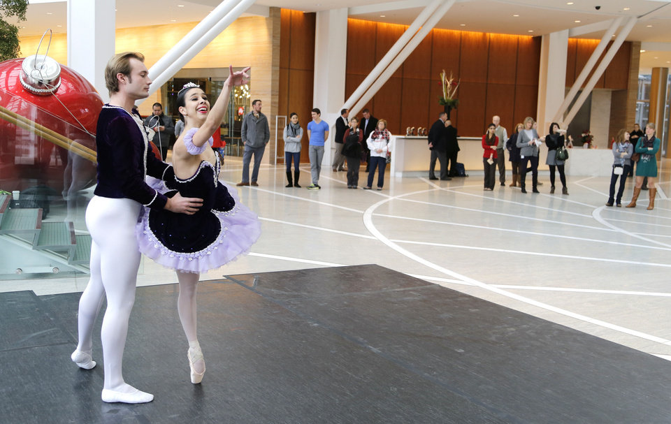 Photo - Ballet Oklahoma dancers Ryan Piper and Ezlimar Dortolina perform the Dance of the Sugar Plum Fairy from The Nutcraker during a presentation for Art Moves at the Devon Energy Center Thursday, December 5, 2013.  Photo by Doug Hoke, The Oklahoman  DOUG HOKE - THE OKLAHOMAN
