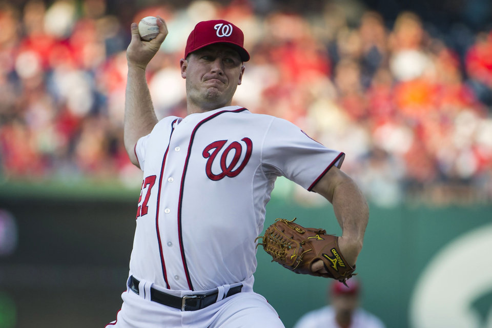 Photo - Washington Nationals starting pitcher Jordan Zimmermann delivers a pitch against the Colorado Rockies during the first inning of a baseball game at Nationals Park, on Monday, June 30, 2014, in Washington. (AP Photo/ Evan Vucci)