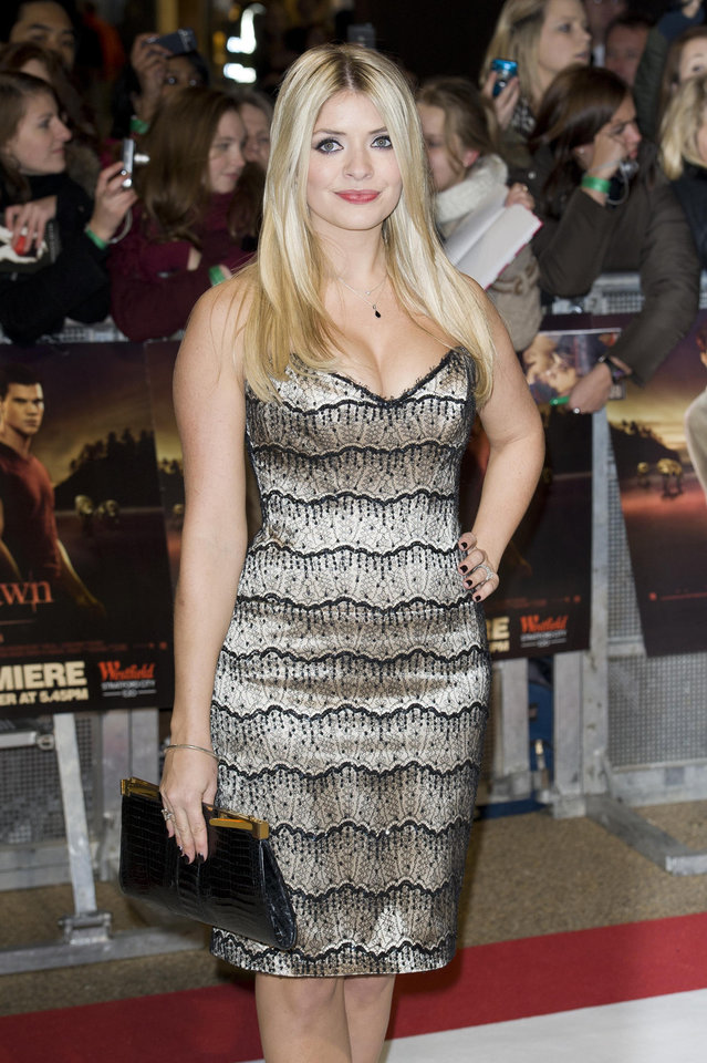 British presenter Holly Willoughby arrives for the UK premiere of 'Twilight Breaking Dawn Part 1' at a central London venue,  Wednesday, Nov. 16, 2011. (AP Photo/Jonathan Short) ORG XMIT: LJS112