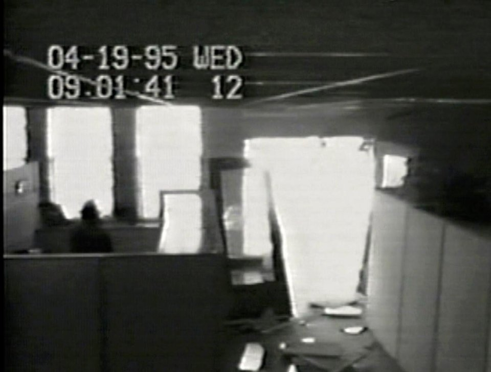 A Southwestern Bell security  camera shows damage to an  entrance of the company's building after the explosion. The time on the recording is slightly behind the established time of the bombing. Image provided by jesse trentadue