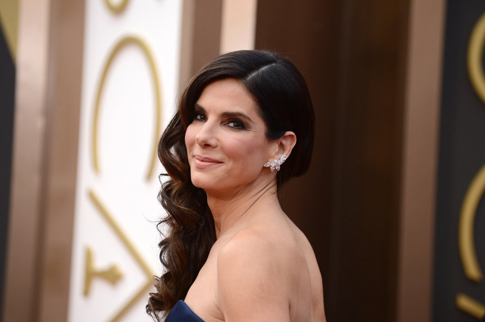 Photo - Sandra Bullock arrives at the Oscars on Sunday, March 2, 2014, at the Dolby Theatre in Los Angeles.  (Photo by Jordan Strauss/Invision/AP)