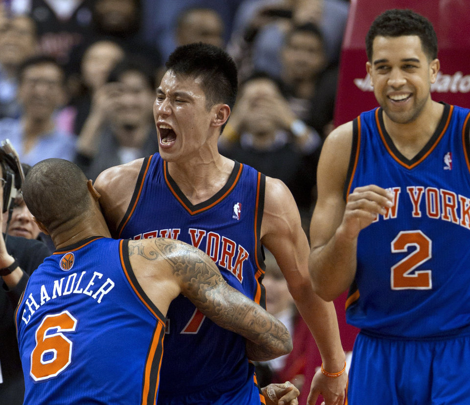 New York Knicks guard Jeremy Lin (17) celebrates with teammates Tyson Chandler and Landry Fields (2) after his game-winning 3-pointer against the Toronto Raptors in an NBA basketball game in Toronto on Tuesday, Feb. 14, 2012. (AP Photo/The Canadian Press, Frank Gunn) ORG XMIT: FNG121