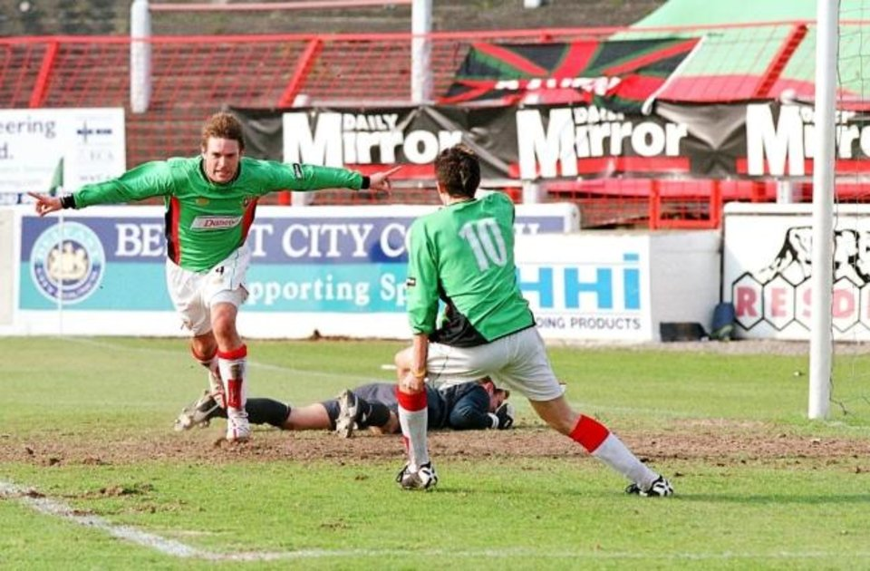 Photo -  Chris Morgan (left) celebrates his last-minute goal in Glentoran FC's win over rival Linfield on April 23, 2005. [PHOTO PROVIDED]