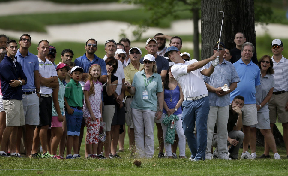 Photo - Kevin Chappell hits from the rough on the first hole during the third round of play at The Barclays golf tournament Saturday, Aug. 23, 2014, in Paramus, N.J. (AP Photo/Mel Evans)