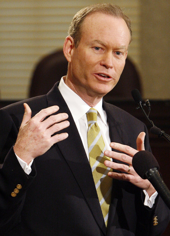 Photo - Oklahoma City Mayor Mick Cornett discusses the vote by the NBA Board of Governors to approve the relocation request of the Seattle SuperSonics to move to Oklahoma City, during a press conference at the city council chambers in Oklahoma City, Friday, April 18, 2008. BY NATE BILLINGS, THE OKLAHOMAN ORG XMIT: KOD