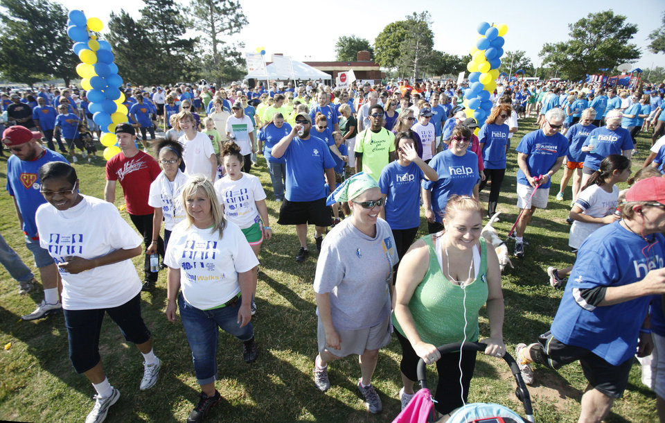 Photo - Walkers participate in the NAMI (National Alliance on Mental Illness) walk at Stars and Stripes Park in Oklahoma City, OK, to raise money for mental illness causes, Saturday, May 19, 2012,  By Paul Hellstern, The Oklahoman