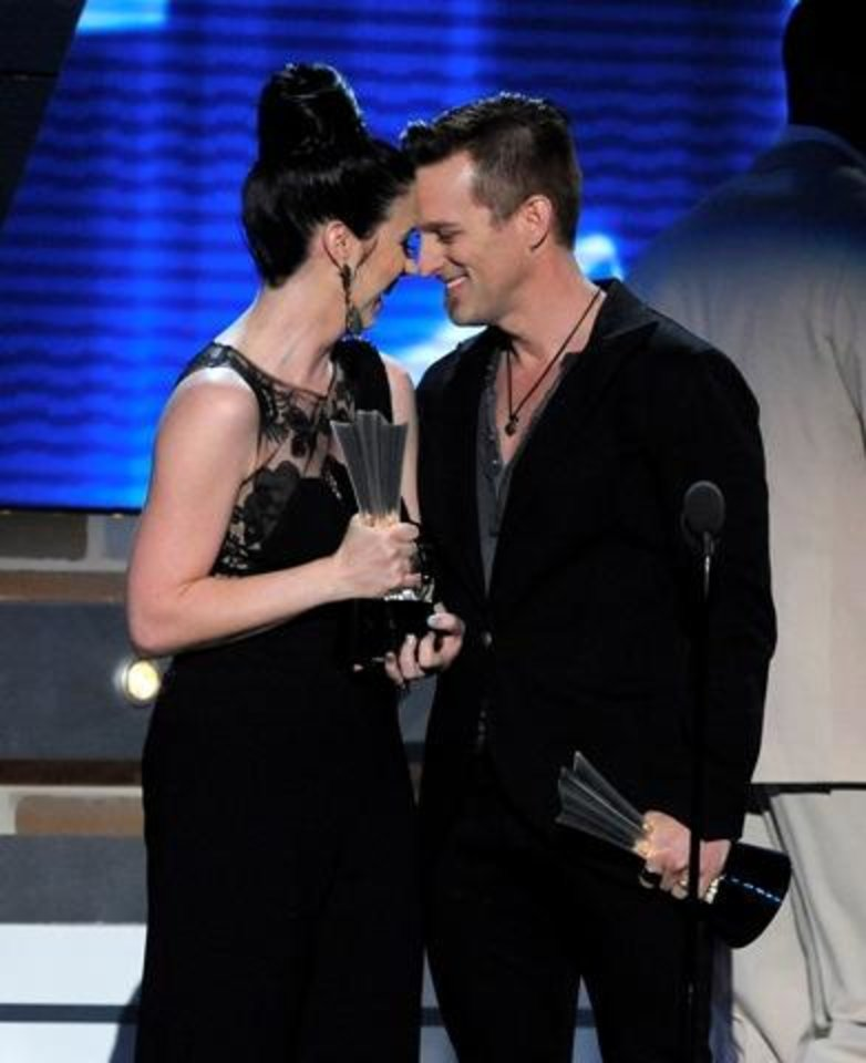 Shawna Thompson, left, and Miami, OK, Keifer Thompson, of Thompson Square, accept the award for vocal duo of the year at the 48th Annual Academy of Country Music Awards at the MGM Grand Garden Arena in Las Vegas on Sunday, April 7, 2013. (AP)
