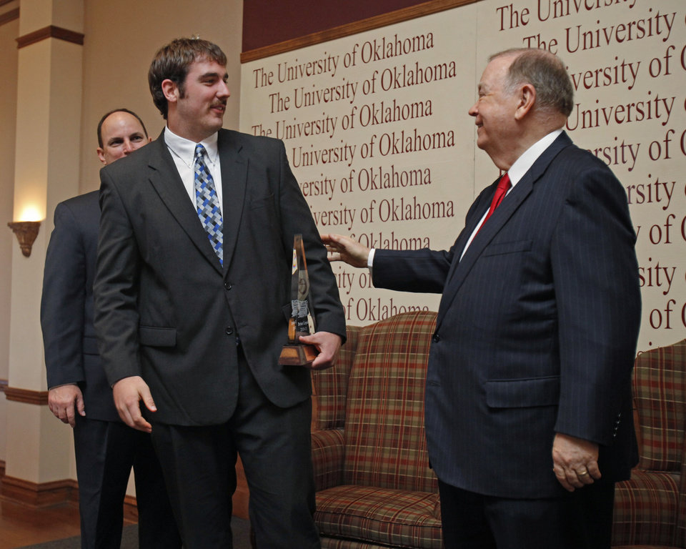 Photo - OU: Brian Lepak (center) receives the Sooner Schooner Scholastic Award from Joe Castiglione (back left) and University of Oklahoma President David Boren at the University of Oklahoma's Scholar Athlete Breakfast on Tuesday, April 12, 2011, in Norman, Okla.   Photo by Steve Sisney, The Oklahoman ORG XMIT: KOD