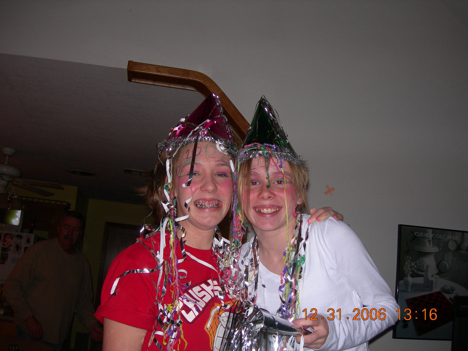Hannah Griffis and Taylor Felgenhauer celebrating the New Year. Recognizing Oklahoma's Centennial Year.<br/><b>Community Photo By:</b> Debbie Felgenhauer<br/><b>Submitted By:</b> Debbie,