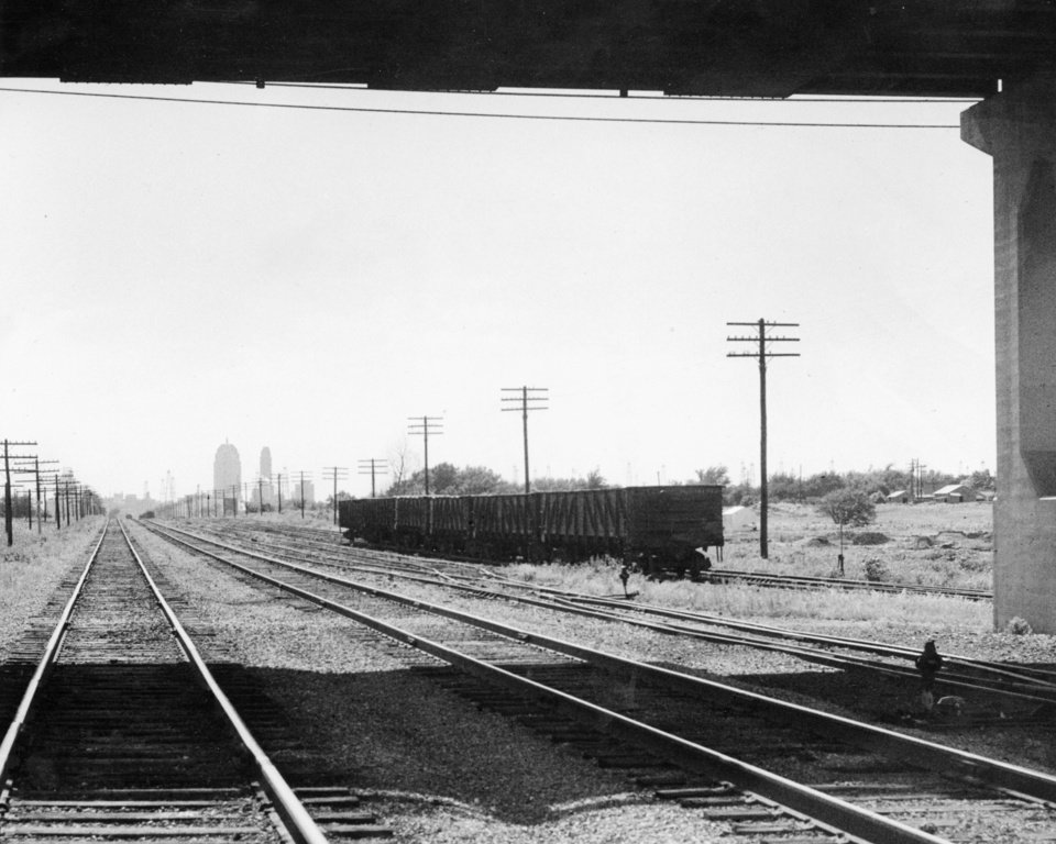 Photo - OKLAHOMA CITY / SKY LINE / OKLAHOMA / TRAIN TRACKS:  No caption.  Staff photo by Al McLaughlin.  Photo dated 06/24/1946 and unpublished.  Photo arrived in library 07/12/1946.