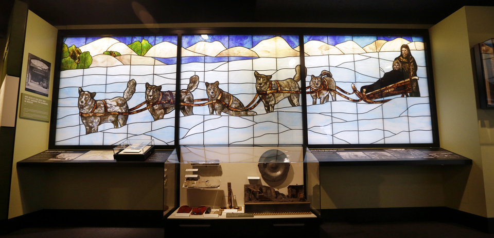 Photo - In this photo taken Wednesday, Dec. 26, 2012, a stained-glass scene from the Arctic Building, part of the museum's collection, is displayed at Seattle's Museum of History and Industry, in the city's South Lake Union neighborhood.