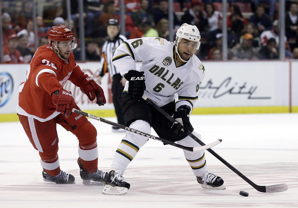 Photo - Detroit Red Wings wing Drew Miller (20) defends Dallas Stars defenseman Trevor Daley (6) during the first period of an NHL hockey game in Detroit, Tuesday, Jan. 29, 2013. (AP Photo/Paul Sancya)