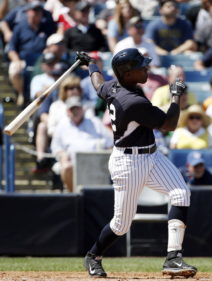 Photo - New York Yankees Alfonso Soriano hits a fourth-inning, two-run home run off Boston Red Sox relief pitcher Brandon Workman in a spring exhibition baseball game in Tampa, Fla., Tuesday, March 18, 2014. (AP Photo/Kathy Willens)