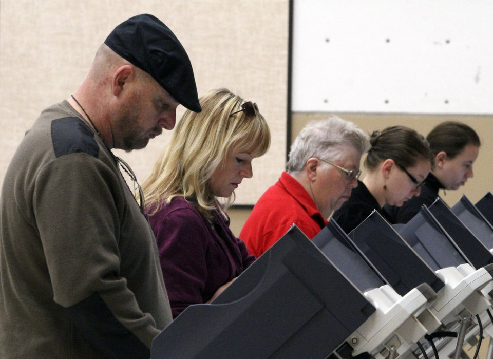 Photo -   Voters cast their ballots on Election Day, Tuesday, Nov. 6, 2012, at Washington Elementary School in Salt Lake City. (AP Photo/The Salt Lake Tribune, Rick Egan) DESERET NEWS OUT; LOCAL TV OUT; MAGS OUT