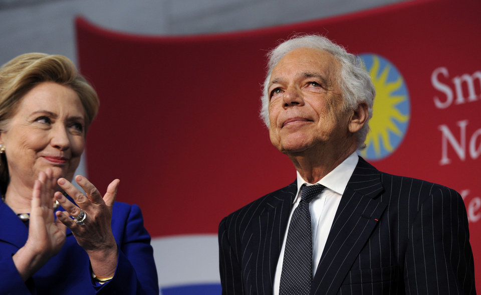 "Photo - Former Secretary of State Hillary Rodham Clinton applauds designer Ralph Lauren after Lauren received the James Smithson Bicentennial Medal ""for his embodiment of the American experience through the medium of fashion, design and philanthropy"