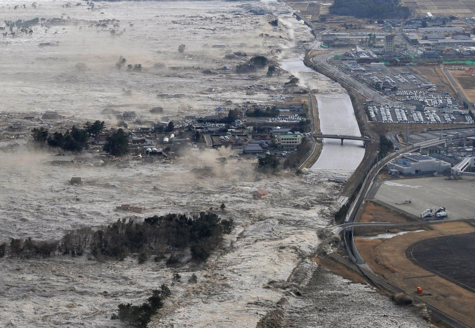 Photo - Earthquake-triggered tsunami waves sweep along Iwanuma in northern Japan on Friday March 11, 2022. The magnitude 8.9 earthquake slammed Japan's eastern coast Friday, unleashing a 13-foot (4-meter) tsunami that swept boats, cars, buildings and tons of debris miles inland. (AP Photo/Kyodo News) JAPAN OUT, MANDATORY CREDIT, FOR COMMERCIAL USE ONLY IN NORTH AMERICA, NO SALES ORG XMIT: TOK843
